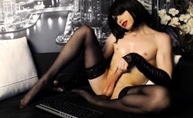 slim-brunette-tranny-in-stockings-jerks-off-her-meat-pole
