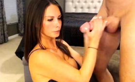 mesmerizing-webcam-milf-with-big-boobs-strokes-a-long-dick