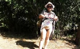 naughty-mature-lady-flashes-her-hairy-beaver-in-the-outdoors