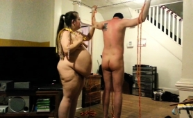 fat-mature-brunette-with-glasses-spanks-her-helpless-slave