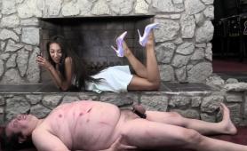 sexy-slender-brunette-dominatrix-punishes-her-chubby-slave