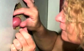 slutty-mature-lady-with-glasses-worships-glory-hole-cocks