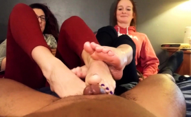 two-sensuous-brunettes-pleasing-a-black-cock-with-their-feet
